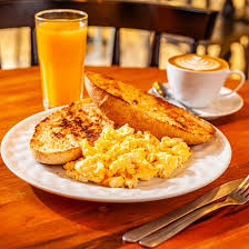 Bread, Juice, Scramble Eggs and Italian Cappuccino