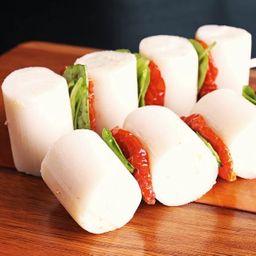 Palmito com tomate seco e rúcula