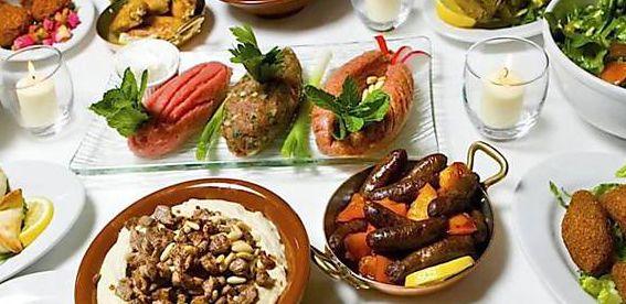 Logo Talal Culinária Síria